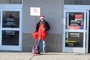 320px-Salvation_Army_red_kettle_at_supermarket_entrance_Ypsilanti_Michigan